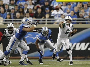 DETROIT - NOVEMBER 07:  Mark Sanchez #6 of the New York Jets throws a pass during the game against the Detroit Lions at Ford Field on November 7, 2010 in Detroit, Michigan. The Jets defeated the Lions 23-20 in overtime.  (Photo by Leon Halip/Getty Images)