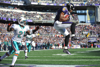 BALTIMORE, MD - NOVEMBER 7:  Derrick Mason #85 of the Baltimore Ravens catches a pass for a touchdown against the Miami Dolphins at M&T Bank Stadium on November 7, 2010 in Baltimore, Maryland. The Ravens defeated the Dolphins 26-10. (Photo by Larry French