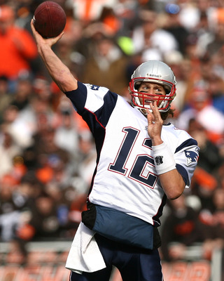 CLEVELAND - NOVEMBER 07:  Quarterback Tom Brady #12 of the New England Patriots throws the ball against the Cleveland Browns at Cleveland Browns Stadium on November 7, 2010 in Cleveland, Ohio.  (Photo by Matt Sullivan/Getty Images)