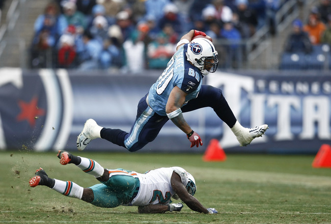 NASHVILLE, TN - DECEMBER 20: Bo Scaife #80 of the Tennessee Titans jumps over Vontae Davis #21 of the Miami Dolphins at LP Field on December 20, 2009 in Nashville, Tennessee. The Titans defeated the Dolphins 27-24 in overtime. (Photo by Joe Robbins/Getty
