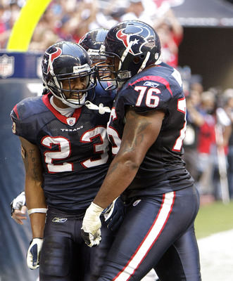 HOUSTON - NOVEMBER 07:  Running back Arian Foster #23 of the Houston Texans celebrates with Duane Brown #76 after scoring against the San Diego Chargers at Reliant Stadium on November 7, 2010 in Houston, Texas.  (Photo by Bob Levey/Getty Images)
