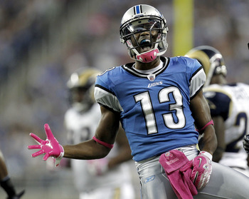DETROIT - OCTOBER 10: Nate Burleson #13 of the Detroit Lions reacts after catching a second quarter pass for a first down while playing the St. Louis Rams on October 10, 2010 at Ford Field in Detroit, Michigan.  (Photo by Gregory Shamus/Getty Images)