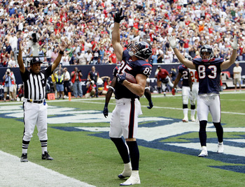 HOUSTON - OCTOBER 17:  Joel Dreessen #85 of the Houston Texans celebrates with Kevin Walter #83 after scoring in the first half against the Kansas City Chiefs at Reliant Stadium on October 17, 2010 in Houston, Texas.  (Photo by Bob Levey/Getty Images)