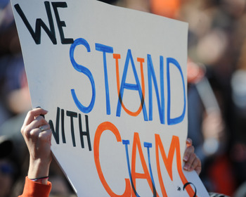 AUBURN, AL - NOVEMBER 06:  Fans of the Auburn Tigers cheer play with signs supporting quarterback Cam Newton against the Chattanooga Mocs November 6, 2010 at Jordan-Hare Stadium in Auburn, Alabama.  (Photo by Al Messerschmidt/Getty Images)