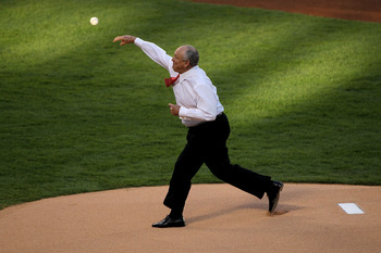 ARLINGTON, TX - OCTOBER 30:  Team President Nolan Ryan of the Texas Rangers throws out the ceremonial first pitch against the San Francisco Giants in Game Three of the 2010 MLB World Series at Rangers Ballpark in Arlington on October 30, 2010 in Arlington