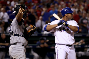ARLINGTON, TX - OCTOBER 22:  Nelson Cruz #17 of the Texas Rangers is intentionally walked by catcher Jorge Posada #20 of the New York Yankees in Game Six of the ALCS during the 2010 MLB Playoffs at Rangers Ballpark in Arlington on October 22, 2010 in Arli
