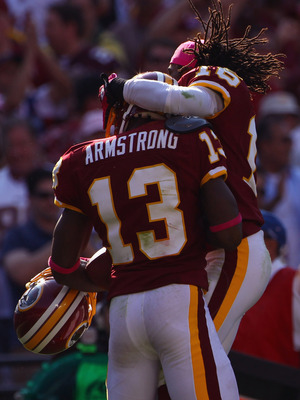 LANDOVER, MD - OCTOBER 10:  Wide receiver Anthony Armstrong #13 of the Washington Redskins celebrates with teammate Brandon Banks #16 after Armstrong caught a touchdown pass in the fourth quarter against the Green Bay Packers at FedExField on October 10,