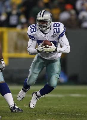 GREEN BAY, WI - NOVEMBER 07: Felix Jones #28 of the Dallas Cowboys runs after picking up a fumble against the Green Bay Packers at Lambeau Field on November 7, 2010 in Green Bay, Wisconsin. The Packers defeated the Cowboys 45-7. (Photo by Jonathan Daniel/