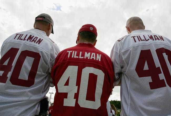 TAMPA, FL - FEBRUARY 01:  Arizona Cardinals fans wearing Pat Tillman jerseys (L-R) Dave Schile, Bruce Goff and Dave Schile Jr. look on outside of Raymond James Stadium before Super Bowl XLIII on February 1, 2009 at Raymond James Stadium in Tampa, Florida.