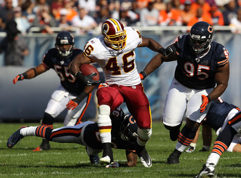 CHICAGO - OCTOBER 24: Ryan Torain #46 of the Washington Redskins runs past Tim Jennings #26 and Anthony Adams #95 of the Chicago Bears at Soldier Field on October 24, 2010 in Chicago, Illinois. The Redskins defeated the Bears 17-14. (Photo by Jonathan Dan