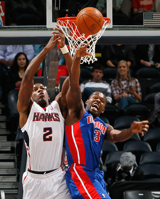 ATLANTA - NOVEMBER 03:  Joe Johnson #2 of the Atlanta Hawks battles for a rebound against Rodney Stuckey #3 of the Detroit Pistons at Philips Arena on November 3, 2010 in Atlanta, Georgia.  NOTE TO USER: User expressly acknowledges and agrees that, by dow