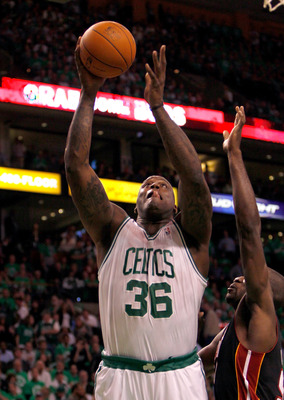 BOSTON, MA - OCTOBER 26: Shaquille O'Neal #36 of the Boston Celtics beats Dwyane Wade #3 of the Miami Heat to the basket at the TD Banknorth Garden on October 26, 2010 in Boston, Massachusetts. NOTE TO USER: User expressly acknowledges and agrees that, by