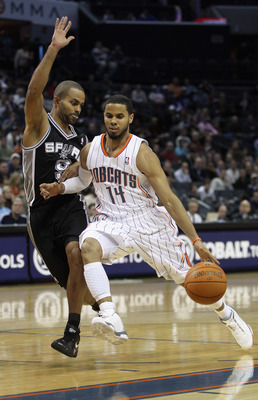 CHARLOTTE, NC - NOVEMBER 08:  Tony Parker #9 of the San Antonio Spurs tries to stop D.J. Augustin #14 of the Charlotte Bobcats during their game at Time Warner Cable Arena on November 8, 2010 in Charlotte, North Carolina.  NOTE TO USER: User expressly ack