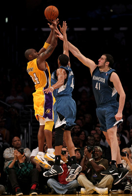 LOS ANGELES, CA - NOVEMBER 09:  Kobe Bryant #24 of the Los Angeles Lakers shoots over Wes Johnson #4 and Kosta Koufos #41 of the Minnesota Timberwolves at Staples Center on November 9, 2010 in Los Angeles, California.  The Lakers won 99-94.  NOTE TO USER: