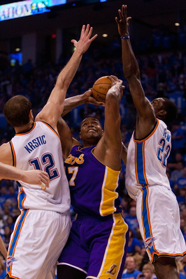 OKLAHOMA CITY - APRIL 30: Andrew Bynum #17 of the Los Angeles Lakers looks to shoot the ball against Jeff Green #22 and Nenad Krstic  #12 both of the Oklahoma City Thunder during Game Six of the Western Conference Quarterfinals of the 2010 NBA Playoffs on