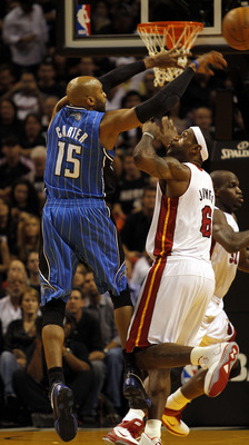 MIAMI - OCTOBER 29:  Forward LeBron James #6 of  the Miami Heat defends against guard Vince Carter #15 of the Orlando Magic at American Airlines Arena on October 29, 2010 in Miami, Florida.  NOTE TO USER: User expressly acknowledges and agrees that, by do