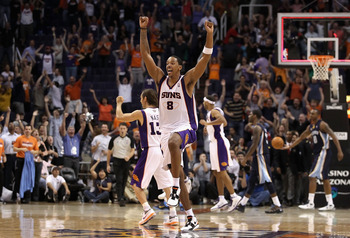 PHOENIX - NOVEMBER 05:  Channing Frye #8 of the Phoenix Suns celebrates after Jason Richardson tied the game in the final seconds to force overtime against the Memphis Grizzlies during the NBA game at US Airways Center on November 5, 2010 in Phoenix, Ariz