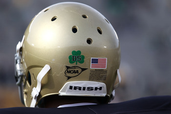 SOUTH BEND, IN - OCTOBER 30: A player for the Notre Dame Fighting Irish wears a decal on his helmut honoring Declan Sullivan, a student who was killed while videotaping a Notre Dame practice in high winds this past week, before a game against the Tulsa Go