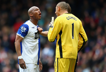 BLACKBURN, UNITED KINGDOM - APRIL 04:  El Hadji Diouf of Blackburn Rovers argues with Huerelho Gomes and Jonathan Woodgate of Tottenham Hotspur during the Barclays Premier League match between Blackburn Rovers and Tottenham Hotspur at Ewood Park on April