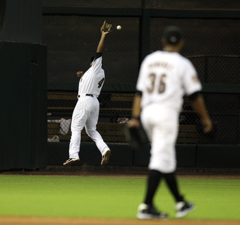 HOUSTON - JULY 30:  Left fielder Carlos Lee #45 makes a leaping attempt on a ball hit by Casey McGehee of the Milwaukee Brewers in the fourth inning at Minute Maid Park on July 30, 2010 in Houston, Texas.  (Photo by Bob Levey/Getty Images)
