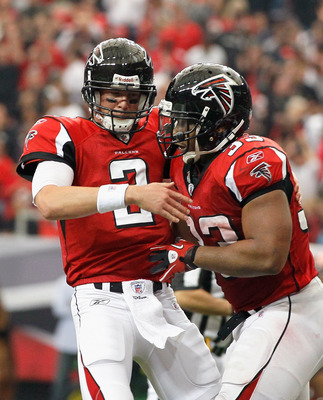 ATLANTA - NOVEMBER 07:  Quarterback Matt Ryan #2 of the Atlanta Falcons celebrates with Michael Turner #33 after Turner's touchdown against the Tampa Bay Buccaneers at Georgia Dome on November 7, 2010 in Atlanta, Georgia.  (Photo by Kevin C. Cox/Getty Ima