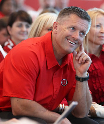 SALT LAKE CITY, UT - JUNE 17: University of Utah Head football coach Kyle Whittingham smiles as it is announced that the University will be admitted into the PAC-10 June 17, 2010 in Salt Lake City, Utah. The University of Utah was invited to join the PAC-