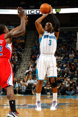NEW ORLEANS - NOVEMBER 09:  Chris Paul #3 of the New Orleans Hornets shoots the ball over Eric Bledsoe #12 of the Los Angeles Clippers at the New Orleans Arena on November 9, 2010 in New Orleans, Louisiana.  NOTE TO USER: User expressly acknowledges and a