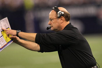 MINNEAPOLIS - NOVEMBER 07:  Head coach Brad Childress of the Minnesota Vikings signals during the game with the Arizona Cardinals at Hubert H. Humphrey Metrodome on November 7, 2010 in Minneapolis, Minnesota. The Vikings won 27-24 in overtime. (Photo by S