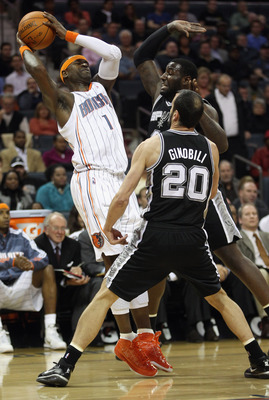 CHARLOTTE, NC - NOVEMBER 08:  Teammates Manu Ginobili #20 and DeJuan Blair #45 of the San Antonio Spurs try to trap Stephen Jackson #1 of the Charlotte Bobcats during their game at Time Warner Cable Arena on November 8, 2010 in Charlotte, North Carolina.