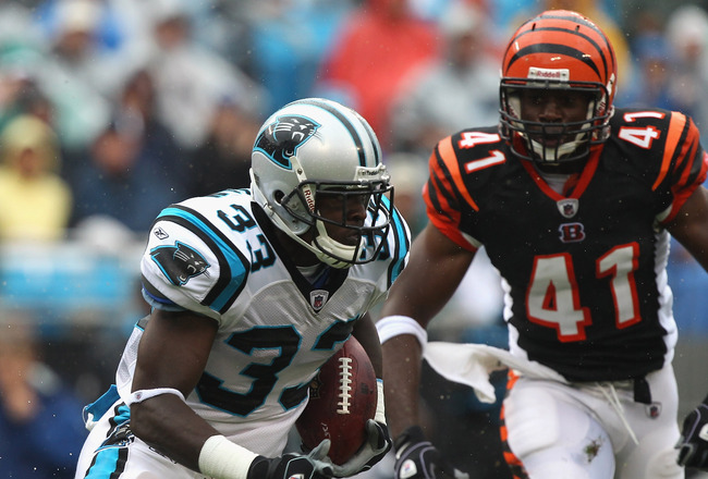 CHARLOTTE, NC - SEPTEMBER 26:  Mike Goodson #33 of the Carolina Panthers runs with the ball against the Cincinnati Bengals during their game at Bank of America Stadium on September 26, 2010 in Charlotte, North Carolina.  (Photo by Streeter Lecka/Getty Ima