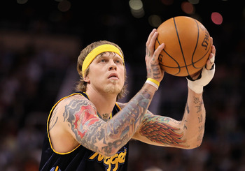 PHOENIX - APRIL 13:  Chris Andersen #11 of the Denver Nuggets shoots a free throw shot against the Phoenix Suns during the NBA game at US Airways Center on April 13, 2010 in Phoenix, Arizona.  The Suns defeated the Nuggets 123-101.  NOTE TO USER: User exp