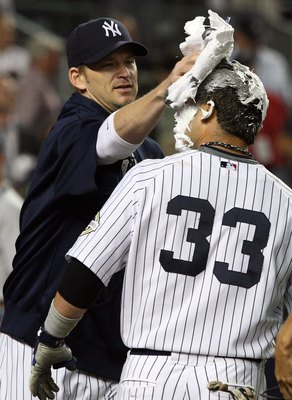 NEW YORK - SEPTEMBER 08:  Nick Swisher #33 of the New York Yankees receives a shaving cream pie from teammate A.J. Burnett #34 after his game winning walk off home run against the Tampa Bay Rays on September 8, 2009 at Yankee Stadium in the Bronx borough