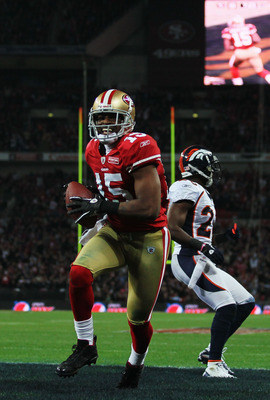 LONDON, ENGLAND - OCTOBER 31:  Michael Crabtree #15 of San Francisco 49ers beats Renaldo Hill #23 of Denver Broncos to score their second touchdown during the NFL International Series match between Denver Broncos and San Francisco 49ers at Wembley Stadium