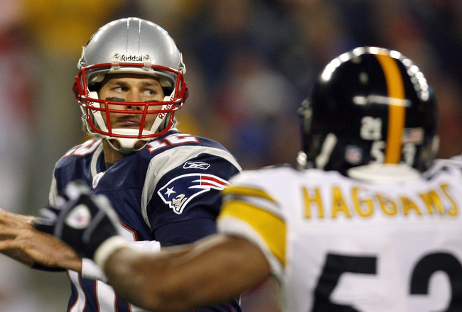 FOXBORO, MA - DECEMBER 9:  Tom Brady #12 of the New England Patriots looks for an open man under the pressure of Clark Haggans #53 of the Pittsburgh Steelers at Gillette Stadium December 9, 2007 in Foxboro, Massachusetts. (Photo by Jim Rogash/Getty Images