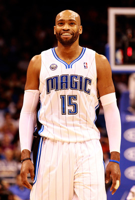 ORLANDO, FL - NOVEMBER 03:  Vince Carter #15 of the Orlando Magic smiles during the game against the Minnesota Timberwolves at Amway Arena on November 3, 2010 in Orlando, Florida.  NOTE TO USER: User expressly acknowledges and agrees that, by downloading