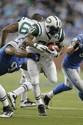 DETROIT - NOVEMBER 07:  LaDainian Tomlinson #21 of the New York Jets runs for a short gain during the third quarter of the game against the Detroit Lions at Ford Field on November 7, 2010 in Detroit, Michigan. The Jets defeated the Lions 23-20 in overtime