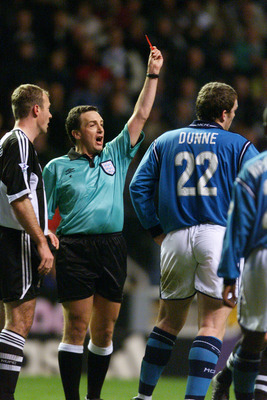 17 Feb 2002:  Referee Alan Wiley shows the red card to Richard Dunne of Manchester City during the AXA sponsored FA Cup fifth round match against Newcastle United played at St James Park, in Newcastle, England. Newcastle United won the match 1-0. DIGITALI