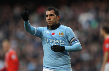 MANCHESTER, ENGLAND - NOVEMBER 13:  Carlos Tevez of Manchester City disputes his disallowed goal with the linesman during the Barclays Premier League match between Manchester City and Birmingham City at City of Manchester Stadium on November 13, 2010 in M
