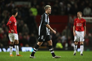 MANCHESTER, UNITED KINGDOM - JANUARY 12:  Alan Smith of Newcastle leaves the pitch after being shown the red card by Referee Rob Styles during the Barclays Premier League match between Manchester United and Newcastle United at Old Trafford on January 12,