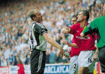15 Sep 2001:  Man Utd Captain Roy Keane takes a swing at Newcastle captain Alan Shearer during the FA Barclaycard Premiership match between Newcastle United and Manchester United played at St. James Park in Newcastle, England.  Newcastle won the match 4-