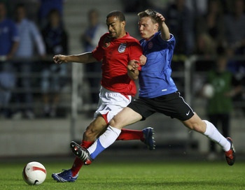 TALLINN, ESTONIA - JUNE 06:  Keiron Dyer of England is challenged by Dmitri Kruglov of Estonia during the Euro2008 Qualifying match between Estonia and England at A. Le Coq Arena on June 6, 2007 in Tallinn, Estonia.  (Photo by Shaun Botterill/Getty Images