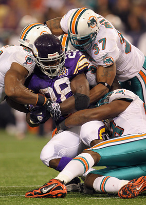 MINNEAPOLIS - SEPTEMBER 19:  Running back Adrian Peterson #28 of the Minnesota Vikings in action during the game against  of the Miami Dolphins on September 19, 2010 at Hubert H. Humphrey Metrodome in Minneapolis, Minnesota.  (Photo by Jamie Squire/Getty