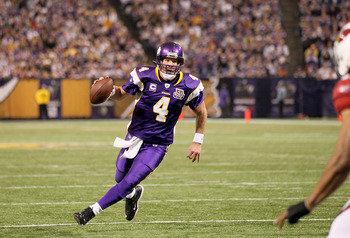 MINNEAPOLIS - NOVEMBER 07:  Quarterback Brett Favre #4 of the Minnesota Vikings runs with the ball against the Arizona Cardinals at Hubert H. Humphrey Metrodome on November 7, 2010 in Minneapolis, Minnesota.  The Vikings won 27-24 in overtime.  (Photo by