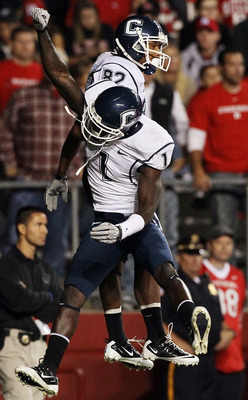 PISCATAWAY, NJ - OCTOBER 08:  Kashif Moore #82 of the Connecticut Huskies celebrates his second-quarter touchdown against the Rutgers Scarlet Knights with teammate Dwayne Difton #1 at Rutgers Stadium on October 8, 2010 in Piscataway, New Jersey.  (Photo b