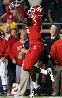 PISCATAWAY, NJ - OCTOBER 08:  Mark Harrison #81 of the Rutgers Scarlet Knights hauls in the game-tying touchdown pass against the Connecticut Huskies at Rutgers Stadium on October 8, 2010 in Piscataway, New Jersey. Rutgers defeated UConn 27-24.  (Photo by