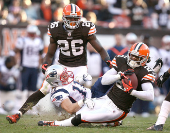 CLEVELAND - NOVEMBER 07:  Defensive back Abram Elam #26 of the Cleveland Browns watches as Eric Wright #21 intercepts the ball in front of wide receiver Julian Edelman #11 of the New England Patriots at Cleveland Browns Stadium on November 7, 2010 in Clev
