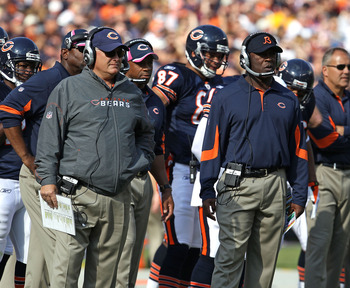 CHICAGO - OCTOBER 24: Offensive coordinator Mike Martz (L) and head coach Lovie Smith of the Chicago Bears watch as their team takes on the Washington Redskins at Soldier Field on October 24, 2010 in Chicago, Illinois. The Redskins defeated the Bears 17-1