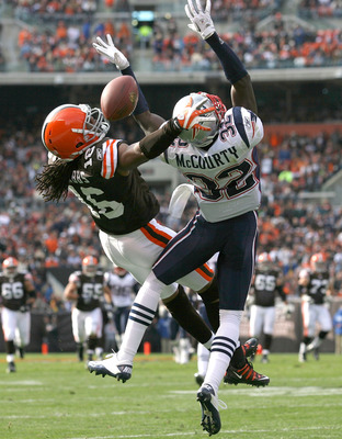 CLEVELAND - NOVEMBER 07:  Wide receiver Joshua Cribbs #16 of the Cleveland Browns jumps for a pass with cornerback Devin McCourty #32 of the New England Patriots at Cleveland Browns Stadium on November 7, 2010 in Cleveland, Ohio.  (Photo by Matt Sullivan/