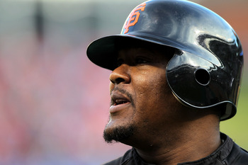 ARLINGTON, TX - NOVEMBER 01:  Juan Uribe #5 of the San Francisco Giants looks on during batting practice against the Texas Rangers in Game Five of the 2010 MLB World Series at Rangers Ballpark in Arlington on November 1, 2010 in Arlington, Texas.  (Photo