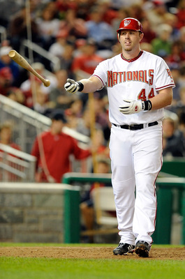 WASHINGTON - SEPTEMBER 29:  Adam Dunn #44 of the Washington Nationals tosses his bat after striking out against the Philadelphia Phillies at Nationals Park on September 29, 2010 in Washington, DC.  (Photo by Greg Fiume/Getty Images)